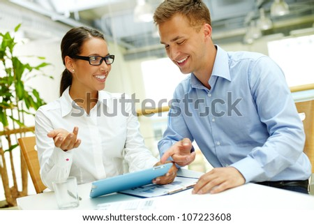 Smiling woman demonstrating the advantages of modern technology - stock photo