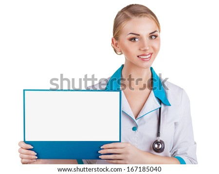 Smiling woman doctor showing blank clipboard sign isolated on white background