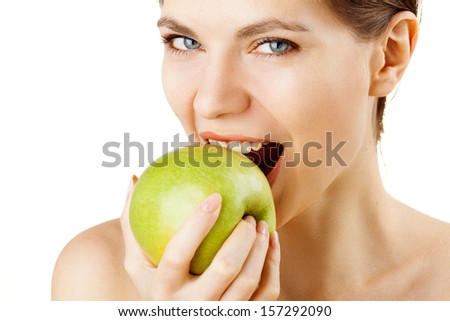 Smiling woman eat green apple - stock photo