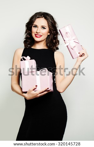 Smiling Woman Fashion Model Showing Holding Gift Box - stock photo