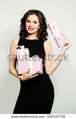 Smiling Woman Fashion Model Showing Holding Gift Box - stock photo