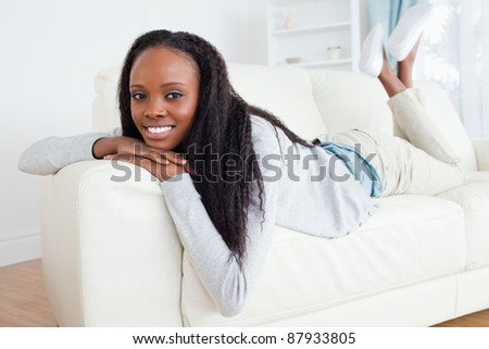 Smiling woman having a moment of relaxation on sofa