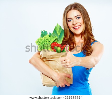 Smiling woman hold green food. Thumb up.White  Isolated Portrait.