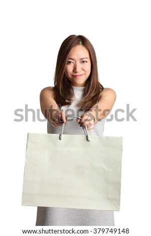 smiling woman hold shopping bag, isolated on white