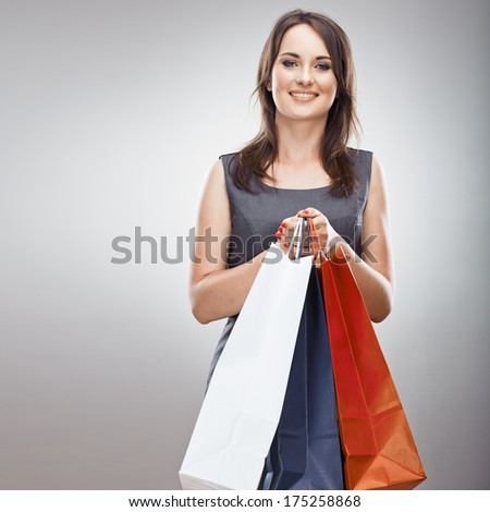 Smiling Woman hold shopping bag. Isolated portrait of young woman with long hair.