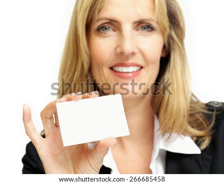 Smiling woman holding a blank business card.