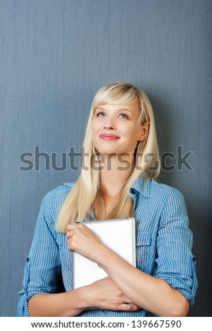 Smiling woman holding a tablet in a front view image