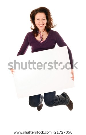 smiling woman holding blank billboard and jumping