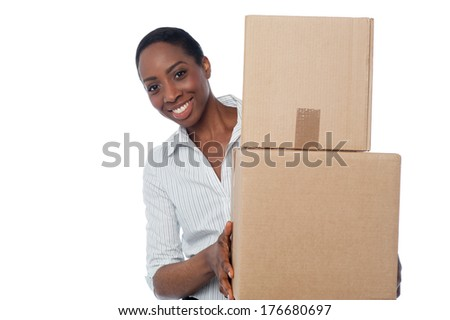 Smiling woman holding cardboard boxes for shipment