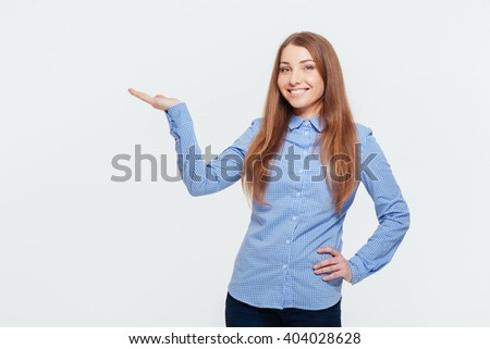 Smiling woman holding copyspace on the palm isolated on a white background - stock photo