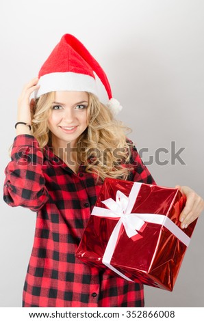 Smiling woman holding cristmas gifts