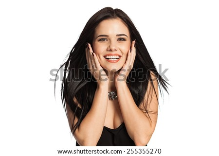 Smiling woman holding her face, copy space for product or text. Gorgeous white caucasian female model isolated on white background