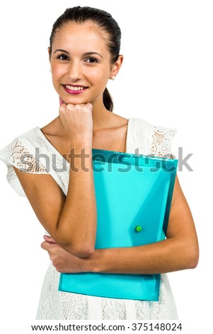 Smiling woman holding plastic holder with fist on chin on white screen - stock photo