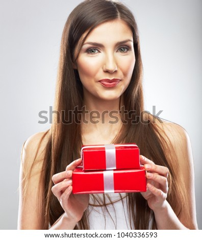 Smiling woman holding red gift box. Beautiful woman isolated studio portrait with present.