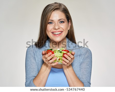 Smiling woman holding salad dish. isolated female portrait.
