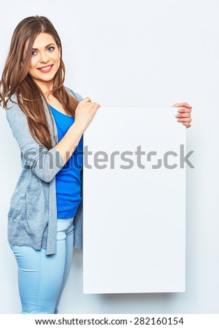 Smiling woman holding signboard. Female model hold white blank business card. - stock photo