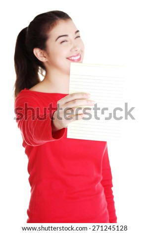 Smiling woman holding small banner. - stock photo