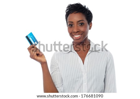Smiling woman holding up her cash card - stock photo