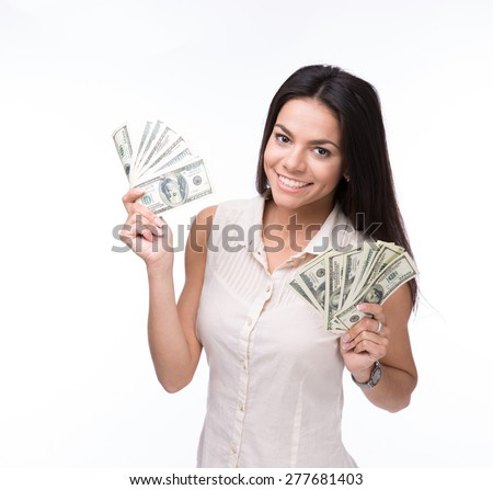 Smiling woman holding US dollar bills over white background and looking at camera