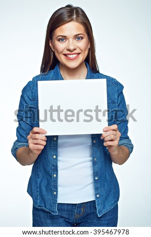 Smiling woman holding white sign board. Casual dressed girl with advertising banner. - stock photo