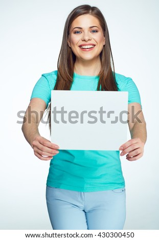 Smiling woman holding white sign board. Girl with long hair hold white banner with copy space. - stock photo