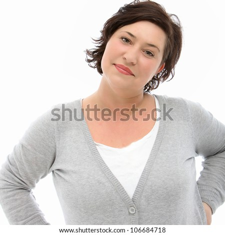 Smiling woman holds a world globe close to her head as she dreams of going on a long vacation sightseeing to wordlwide destinations - stock photo