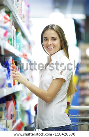 Smiling woman in a Grocery Store - stock photo