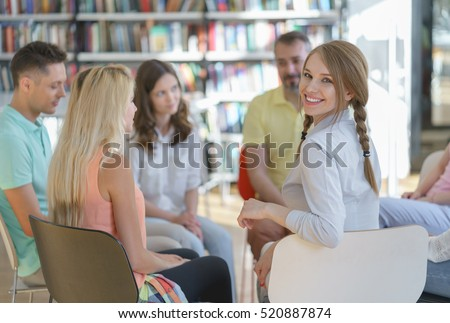 Smiling woman in a library