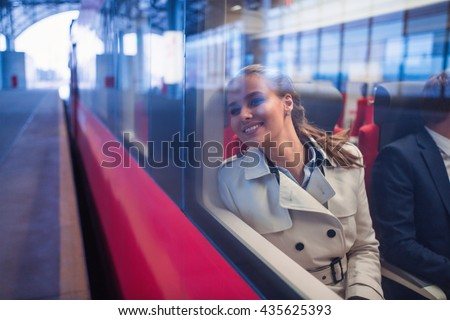 Smiling woman in a train
