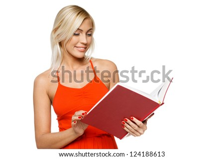 Smiling woman in bright red dress reading a book over white background