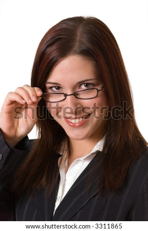 smiling woman in business suit looks at camera over her glasses - stock photo