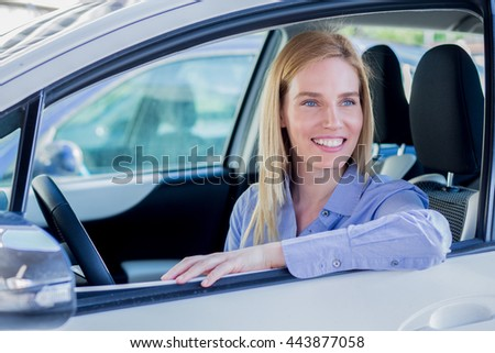 Smiling woman in car