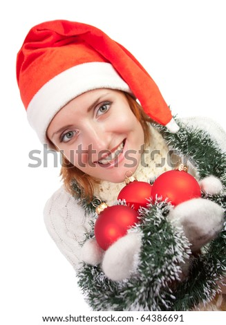 Smiling woman in christmas hat with ornaments