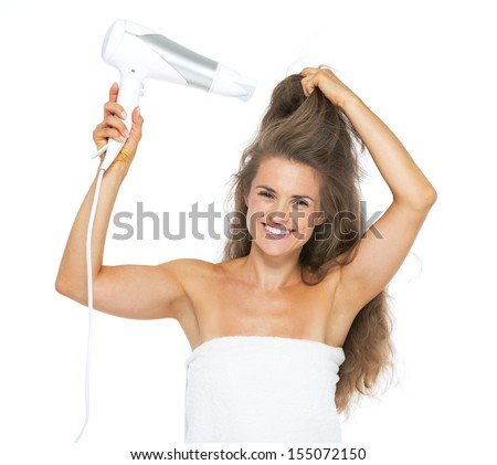 Smiling woman in towel blow-dry