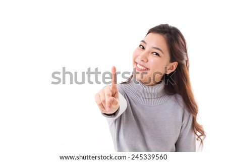 smiling woman in winter outfit showing no.1 or one finger hand gesture, white background with text space - stock photo