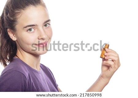 smiling woman is holding a bottle of homeopathic medicine, isolated on white.