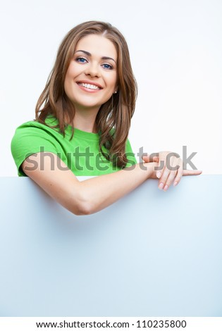 Smiling woman leaning on big blank board . Close up female face portrait with arms on blank card. - stock photo