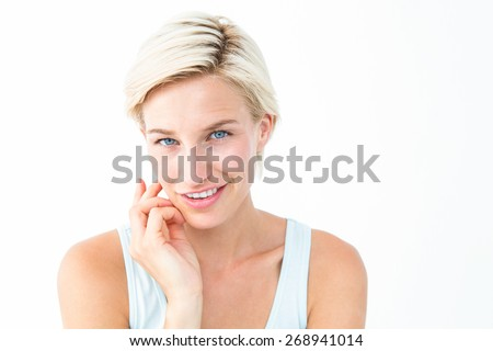 Smiling woman looking at camera on white background - stock photo