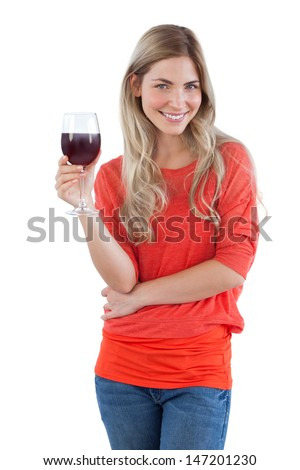 Smiling woman looking at the camera with red wine glass on a white background - stock photo