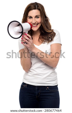 Smiling woman making advertise with megaphone - stock photo