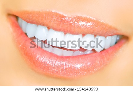 Smiling woman mouth with great teeth. Over white background. - stock photo