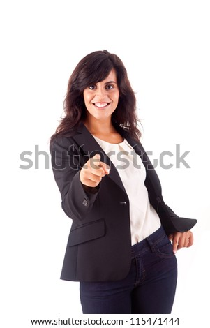 Smiling woman pointing for something front - stock photo