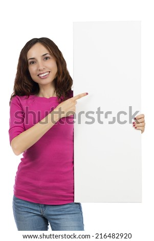 Smiling woman pointing to a billboard