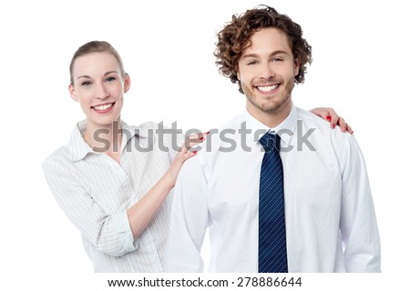 Smiling woman posing behind her colleague - stock photo