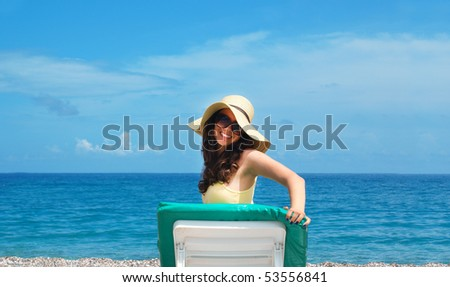 Smiling woman relaxing at the seaside
