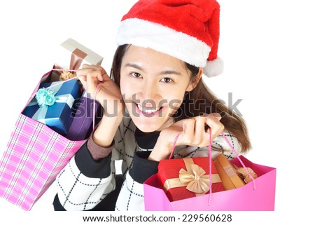 smiling woman  santa helper hat with shopping bags - stock photo