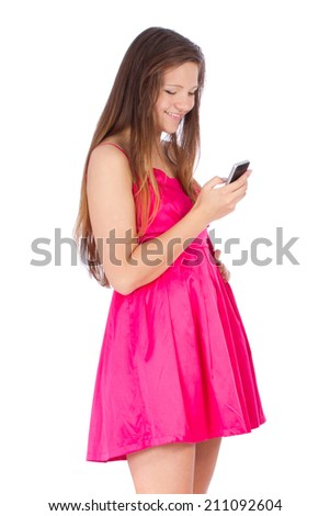 Smiling woman sending a message with mobile phone, isolated on w