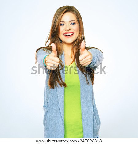 Smiling woman show thumb. Portrait of young model with long hair isolated on white background. - stock photo