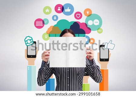 Smiling woman showing a big business card in front of her face against grey background - stock photo