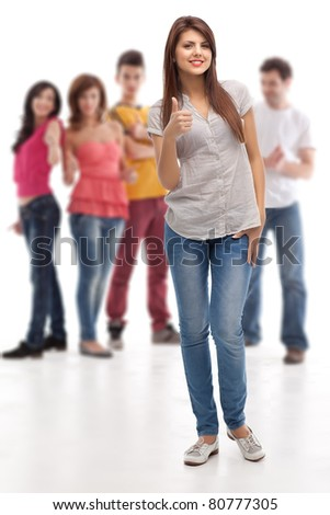 smiling woman showing ok sign, posing in front of approving group - stock photo
